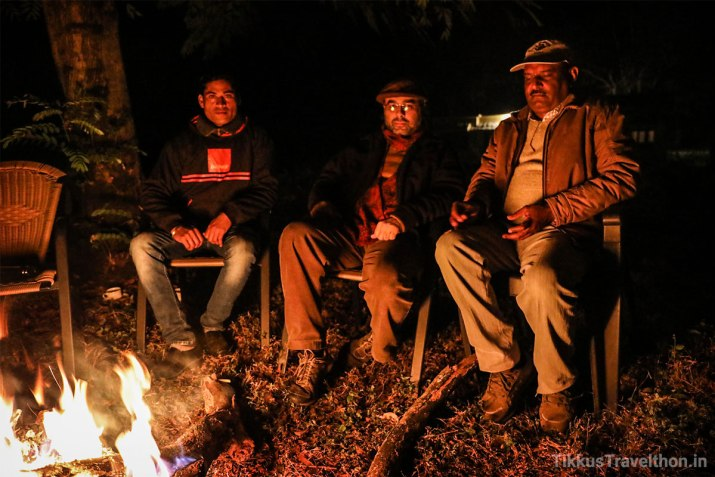 Janak and the park staff around the bonfire.
